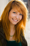 Beautiful young redhead smiling. Stock Photos