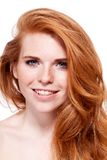 Beautiful young redhead woman with freckles portrait Royalty Free Stock Photography
