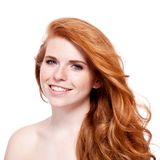 Beautiful young redhead woman with freckles portrait. Isolated on white stock images