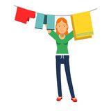 Beautiful young redhead woman hanging wet clothes out to dry, home cleaning and homework  Illustration. On a white background Stock Photo