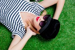 Beautiful young redhead woman in hat and sunglasses Royalty Free Stock Photography