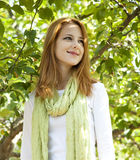 Beautiful young redhead woman near the apple tree Stock Photos