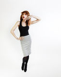 Beautiful young redhead woman in studio. Stock Photos
