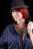 Beautiful young redhead woman wearing hat Stock Photography