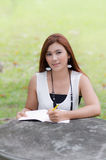 Beautiful young redhead woman writing a notebook Royalty Free Stock Photos