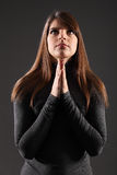 Beautiful young religious woman looking up praying Royalty Free Stock Image