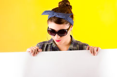 Beautiful young retro girl holding white paper Royalty Free Stock Photography