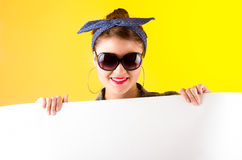 Beautiful young retro girl holding white paper Royalty Free Stock Image