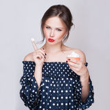 Beautiful young retro pinup woman eat sweet cake food  on white iin studio Royalty Free Stock Images