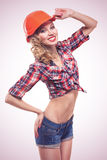 Young pinup woman with hardhat  Royalty Free Stock Photos