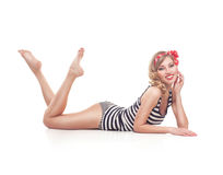 Young pinup woman isolated on white. Beautiful young retro pinup woman isolated on white background stock images