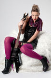 Beautiful young rock girl with black guitar Royalty Free Stock Photo