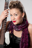 Beautiful young rock girl with black guitar Royalty Free Stock Photography