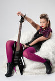 Beautiful young rock girl with black guitar Royalty Free Stock Photos