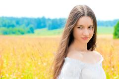 Beautiful young Russian girl in field with gold ears of wheat Royalty Free Stock Images