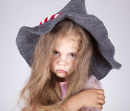 Beautiful young sad girl in cap. Studio shot Royalty Free Stock Photography