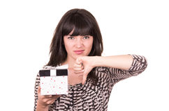 Beautiful young sad girl holding present wrapped in a box Royalty Free Stock Photography