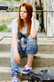 Beautiful young sad girl sitting on staircase. Beautiful young sad girl sitting on the staircase Stock Photos