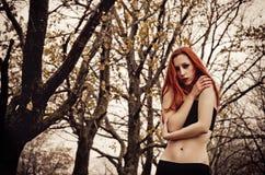 Beautiful young sad girl among the trees Royalty Free Stock Image