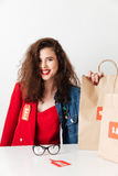 Beautiful young sale woman sitting with paper shopping bags Stock Photo