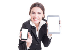 Beautiful young sales female showing modern technology devices. With blank white screen or display ready for advertising Stock Photo