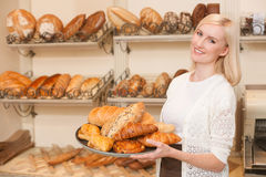 Beautiful young saleswoman is working in bakery Stock Photos