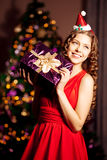 Beautiful young santa girl. Luxury richest woman in the Christma Royalty Free Stock Photography
