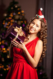 Beautiful young santa girl. Luxury richest woman in the Christma Stock Photos