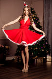 Beautiful young santa girl. Luxury richest woman in the Christma Royalty Free Stock Photo