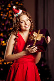 Beautiful young santa girl. Luxury richest woman in the Christma Stock Photo