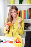 Beautiful young secretary drinking coffee Royalty Free Stock Image