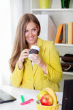 Beautiful young secretary drinking a cup of tea Stock Image