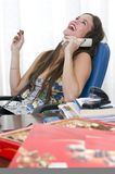 Beautiful young secretary laughing and phone Stock Images