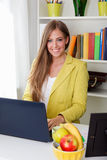 Beautiful young secretary working on laptop Stock Image