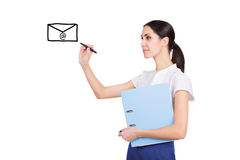 Beautiful young secretary writing a message. Beautiful young secretary in formalware with documents and pen writing an email with creative ideas Stock Photography