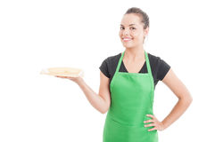 Beautiful young seller serving something on plate Royalty Free Stock Images