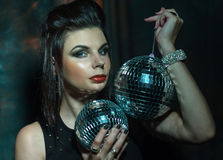 Beautiful young sensual woman holding disco ball Stock Images