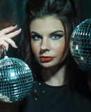Beautiful young sensual woman holding disco ball Stock Photos
