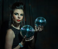 Beautiful young sensual woman holding disco ball Stock Image