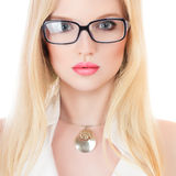 Beautiful young serious woman. In glasses isolated on white background Stock Images