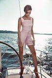 Beautiful brunette girl in dress makeup summer trip yacht stock photos