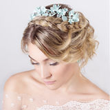 Beautiful young elegant sweet girl in the image of a bride with hair and flowers in her hair , delicate wedding makeup stock photo