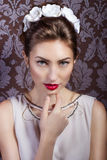 Beautiful young sexy elegant woman with red lips, beautiful stylish hairstyle with white flowers in her hair, the way Royalty Free Stock Photos