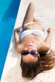 Beautiful, young, sexy girl enjoy in the summer near the pool. Royalty Free Stock Photos
