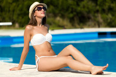 Beautiful, young, sexy girl enjoy in the summer near the pool. Royalty Free Stock Photography