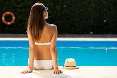 Beautiful, young, sexy girl enjoy in the summer near the pool. Stock Photo