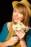 The beautiful young sexy girl with flowers in the hand Royalty Free Stock Images