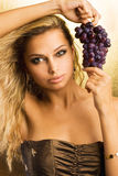 Beautiful young sexy girl with grapes Stock Photos