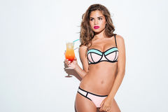 Beautiful young sexy girl holding cocktail wearing bikini Royalty Free Stock Image