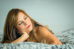Beautiful young sexy latin woman lying in bed Royalty Free Stock Images